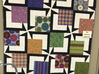 "Quilt Haven on Main www.quilthavenonmain.com  created this fabulous version. 20- 13 1/2"" blocks 54"" x 67.5""."